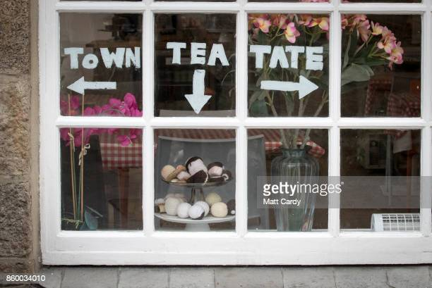 Signs in the window of a cafe point towards Tate St Ives which is set to reopen to the public this weekend after a fouryear £20 million...