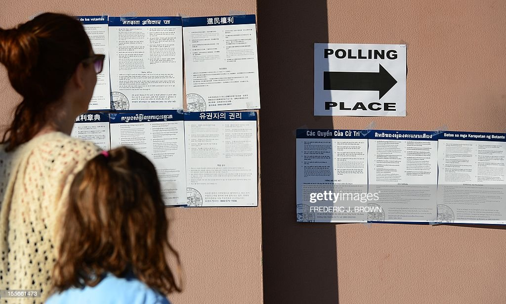 Signs in various languages direct voters to a polling stations at the Alhambra Fire Station #71 in Alhambra, Los Angeles County, on November 6, 2012 in California. Alhambra is one of 6 cities in California's 49th Assembly District, the state's first legislative district where Asian-Americans make up the majority of the population, as Americans flock to the polls nationwide to decide between President Barack Obama, his Rebuplican challenger Mitt Romney, and a wide range of other issues. AFP PHOTO / Frederic J. BROWN