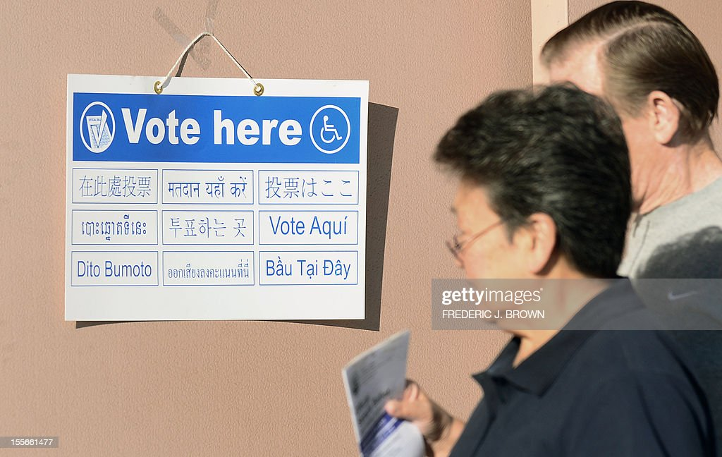 Signs in various languages direct voters to polling stations at the Alhambra Fire Station #71 in Alhambra, Los Angeles County, on November 6, 2012 in California. Alhambra is one of 6 cities in California's 49th Assembly District, the state's first legislative district where Asian-Americans make up the majority of the population, as Americans flock to the polls nationwide to decide between President Barack Obama, his Rebuplican challenger Mitt Romney, and a wide range of other issues. AFP PHOTO / Frederic J. BROWN