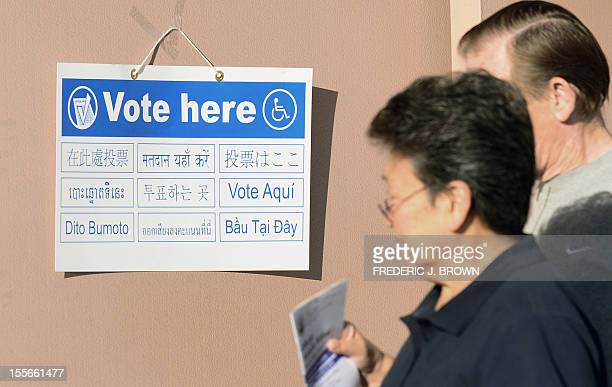 Signs in various languages direct voters to polling stations at the Alhambra Fire Station in Alhambra Los Angeles County on November 6 2012 in...