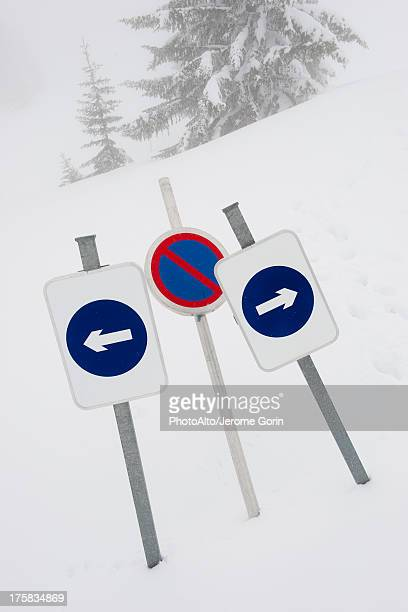 Signs indicating dead end in snow