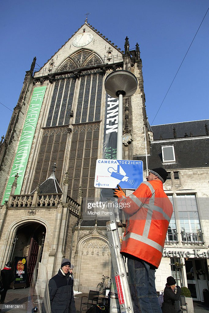 . Signs indicating security camera systems are installed near the Nieuwe Kerk (New Church), the location of the 30 April 2013 coronation of King Willem Alexander of The Netherlands on February 13, 2013 in Amsterdam, Netherlands.