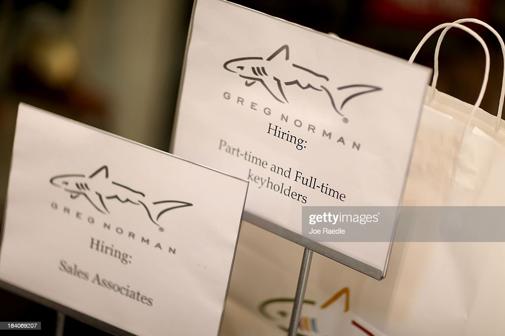 Signs indicating that Greg Norman is hiring are seen during a job fair at Sawgrass Mills on October 11, 2013 in Sunrise, Florida. As the holiday season approaches many of the roughly 50 retailers at the job fair including Banana Republic, J.Crew Factory, Victoria's Secret and Calvin Klein are starting to hire people for seasonal work as well as continuing to look for qualified full time employees.