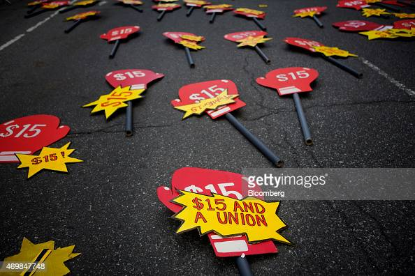 Signs lay in the street before the start of a rally in support of minimum wage increase in New York US on Wednesday April 15 2015 Fastfood workers...