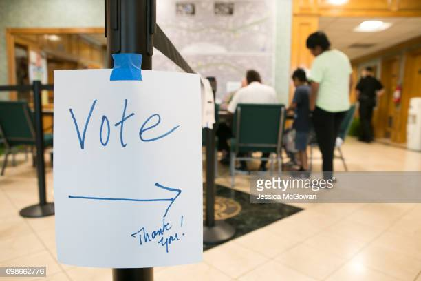 Signs lead voters into the polling location at Doraville City Hall for the special election of Georgia's 6th Congressional District on June 20 2017...