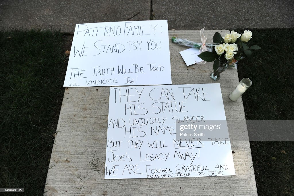 Signs line the sidewalk at former Penn State University football coach Joe Paterno's home on July 22, 2012 in State College, Pennsylvania. Penn State's president Rodney Erickson made the decision Sunday to remove the Joe Paterno statue in the wake of the child sex scandal of former assistant football coach Jerry Sandusky. It's believed that Paterno had detailed knowledge of Jerry Sandusky sexually abusing children before and after Sandusky retired from coaching at Penn State.