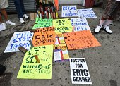 Signs of protesters rallying against police brutality in memory of Eric Garner August 23 2014 in Staten Island New York The New York City medical...