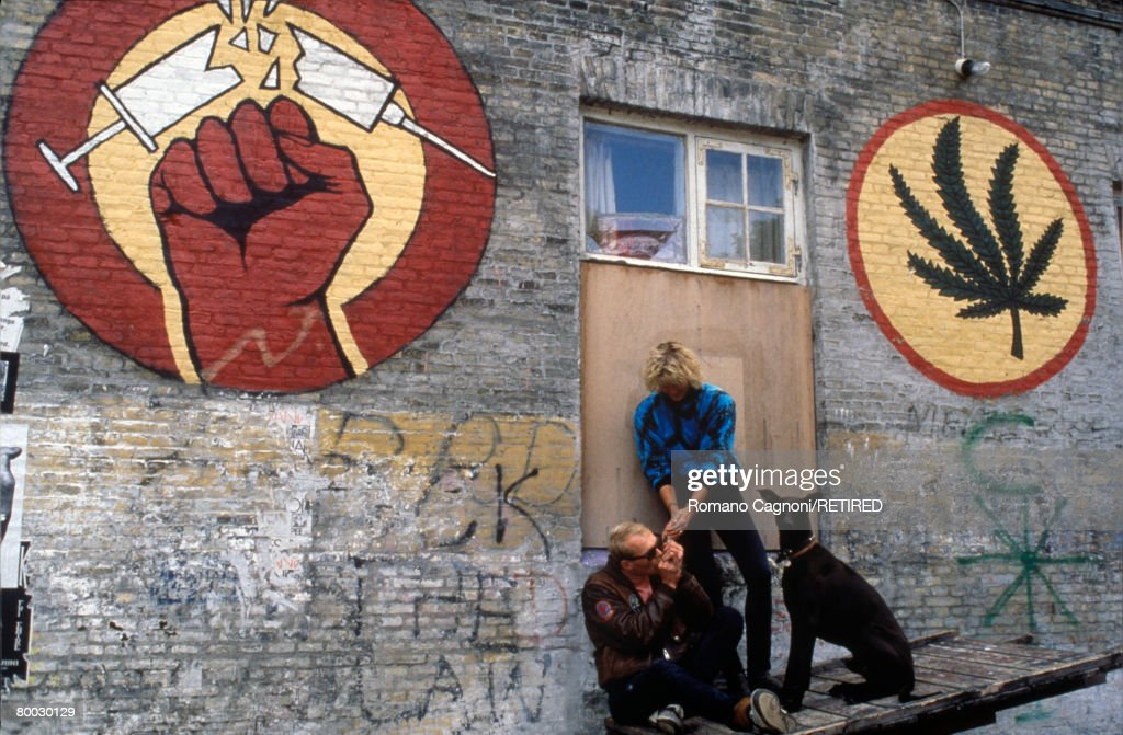 Signs of the drug culture predominant in Freetown Christiania, an area of Copenhagen, circa 1990.