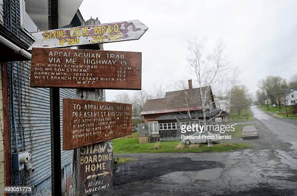 Signs on a post in downtown Monson point the way to the Appalachian Trail boarding homes etc Tuesday May 8 2012