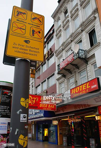 Signs on the Reeperbahn show that the carrying of weapons is now banned on December 17 2007 in Hamburg Germany