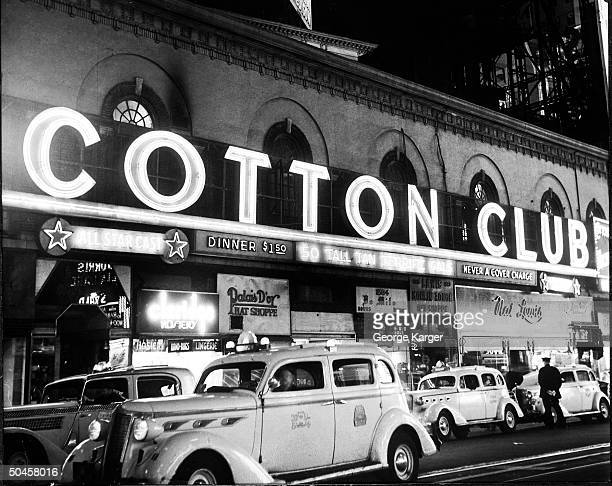 Signs outside the Cotton Club at night