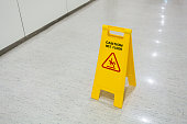 Signs plastic yellow put on floor text caution wet floor in hospital