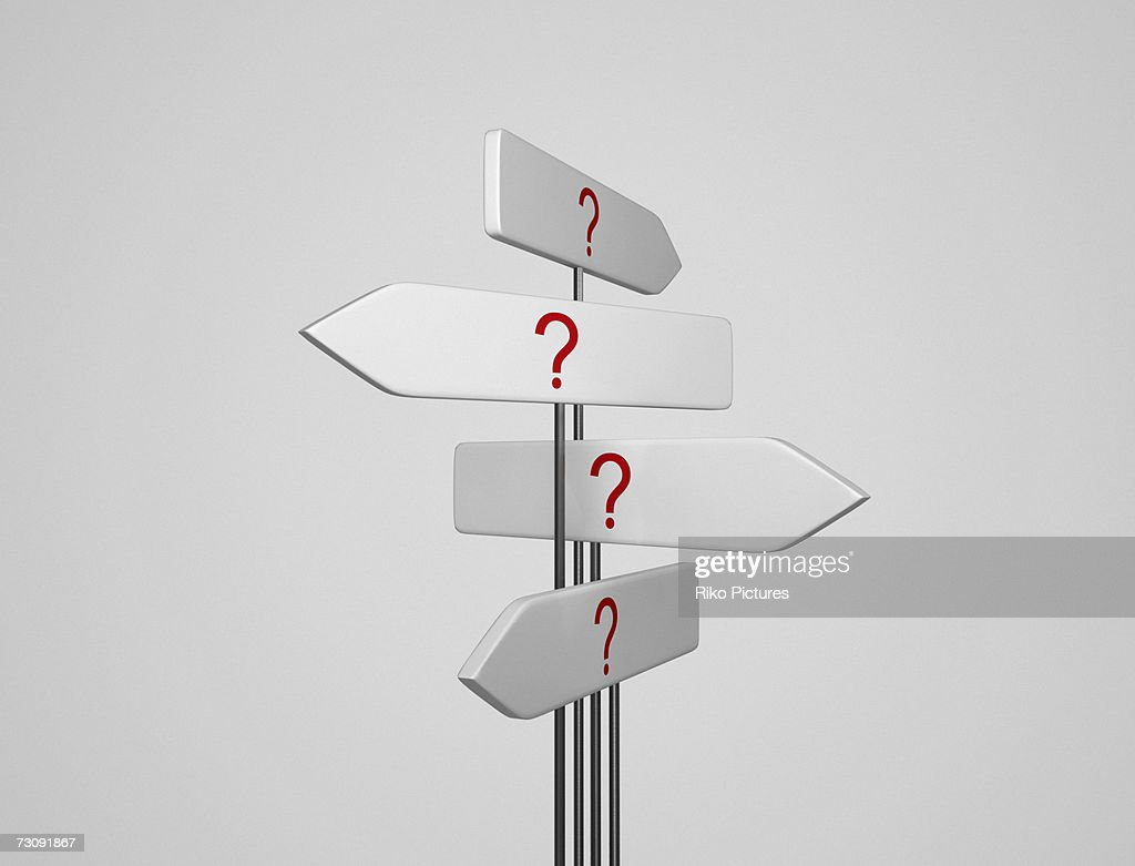Signs pointing in different directions : Stock Photo