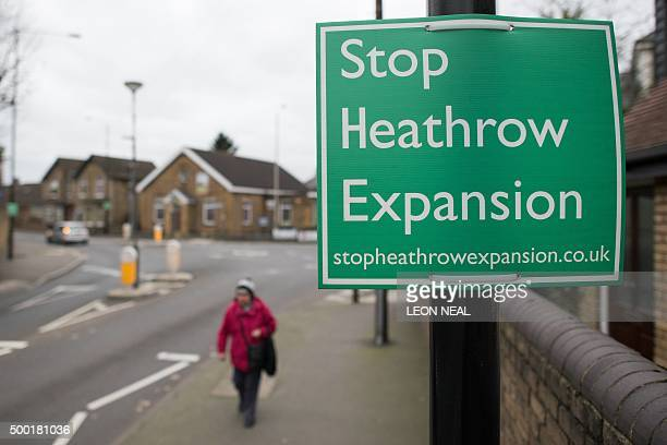 Signs reading 'Stop Heathrow Expansion' protesting against the building of an additional runway at London Heathrow airport are seen around in village...
