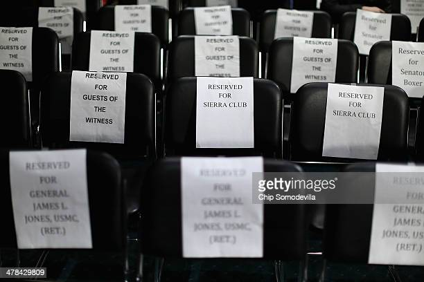 Signs reserve seats before a Senate Foreign Relations Committee hearing about the proposed Keystone XL pipeline project in the Dirksen Senate Office...