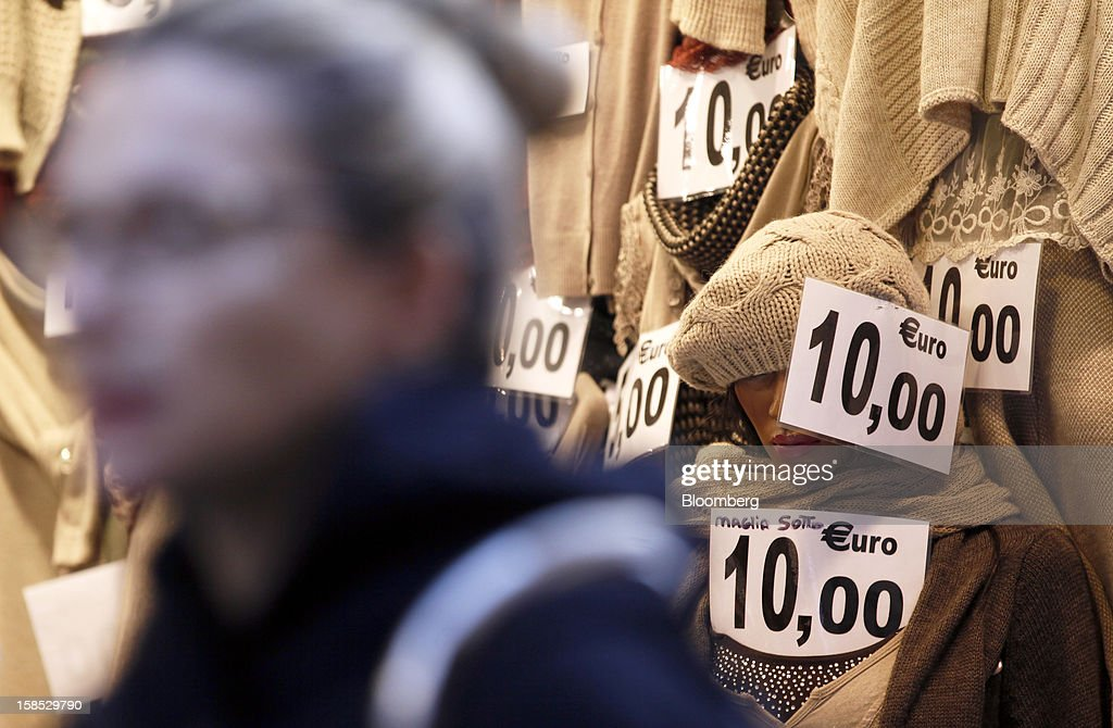 Signs show the cost in euros of women's knitwear displayed for sale on mannequins inside a store in Rome, Italy, on Tuesday, Dec. 18, 2012. Italian Prime Minister Mario Monti, who is under pressure from euro-area and business leaders to enter the Italian election campaign, plans to quit once parliament passes his budget this week. Photographer: Alessia Pierdomenico/Bloomberg via Getty Images