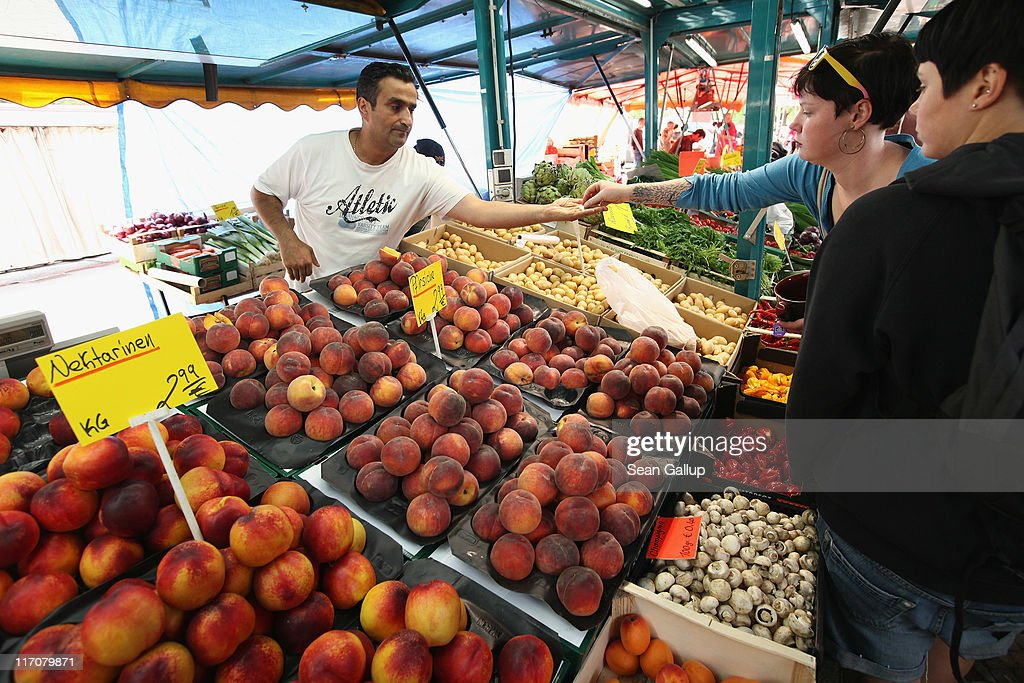 Signs show the prices in Euros while a customer makes a purchase at a fruit and vegetable stand at the Maybacher Ufer outdoor market in Kreuzberg district on June 21, 2011 in Berlin, Germany. Eurozone finance ministers are currently seeking to find a solution to Greece's pressing debt problems, including the prospect of the country's inability to meet its financial obligations unless it gets a fresh, multi-billion Euro loan by July 1. Greece's increasing tilt towards bankruptcy is rattling worldwide financial markets, and leading economists warn that bankruptcy would endanger the stability of the Euro and have dire global consequences.