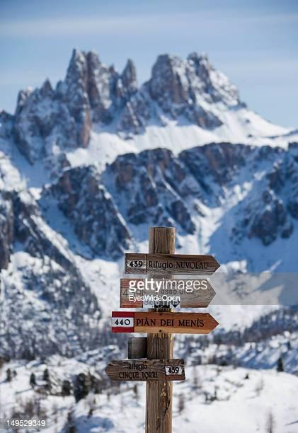 Signs show the way to refugios Averau Cinque Torri Nuvolau near at the alpine mountain hut Rifugio Scoiattoli at the famous rocks Cinque Torri in the...