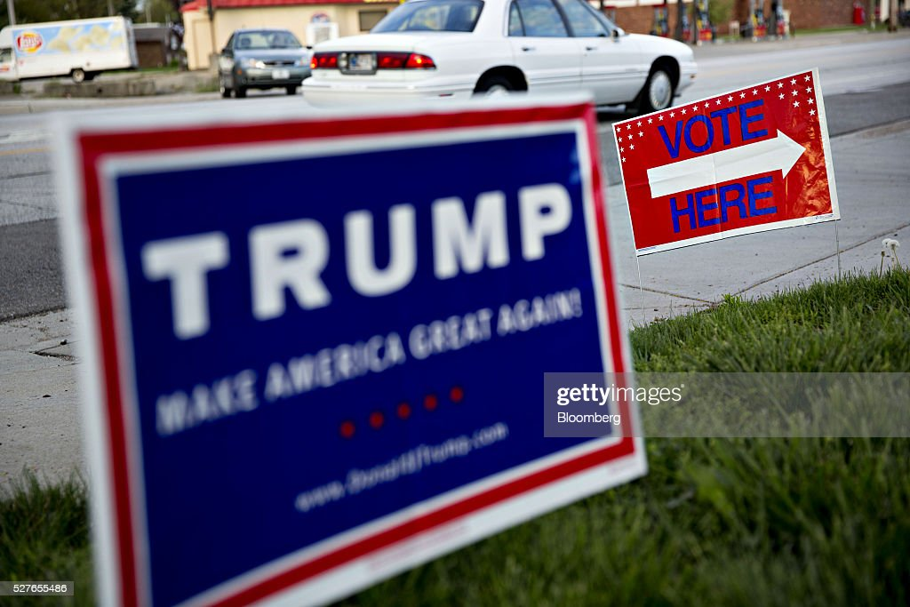Signs stand outside a polling station in South Bend, Indiana, U.S., on Tuesday, May 3, 2016. The outcome in Indiana, where balloting across two time zones will end at 7 p.m. Eastern time, could yield a deciding moment as the presidential race enters the home stretch. Photographer: Daniel Acker/Bloomberg via Getty Images