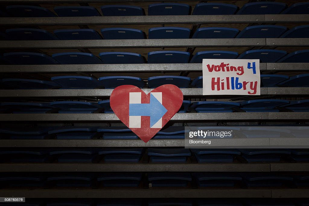 Signs supporting Hillary Clinton, former Secretary of State and 2016 Democratic presidential candidate, hang following a campaign event in Concord, New Hampshire, U.S., on Saturday, Feb. 6, 2016. Trailing Bernie Sanders in the Democratic contest by 20 percentage points or more in some polls of voters in the state, Clinton recalled that New Hampshire gave her a come-from-behind victory in the 2008 primary race and a dramatic boost to her husband, Bill Clinton, in his first run for the presidency in 1992. Photographer: Daniel Acker/Bloomberg via Getty Images