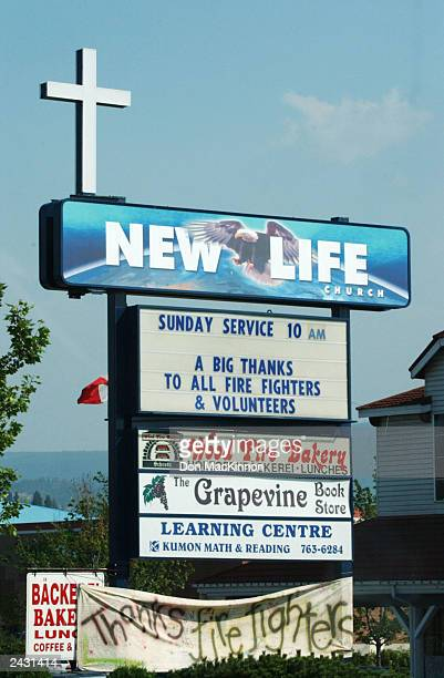 Signs thank firefighters battling a wildfire burning in the Okanagan Mountain Park August 26 2003 near Kelowna British Columbia Canada The fire tore...