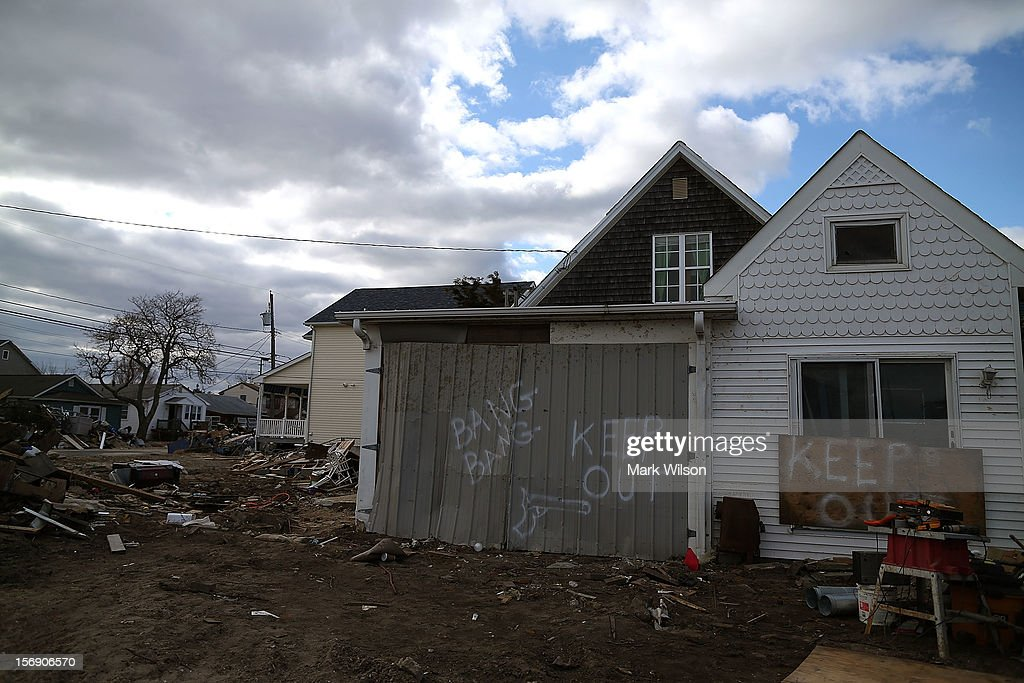Signs warning people to keep out are posted on a home damaged by Superstorm Sandy, on November 24, 2012 in Ortley Beach, New Jersey. New Jersey Gov. Christie estimated that Superstorm Sandy cost New Jersey $29.4 billion in damage and economic losses.