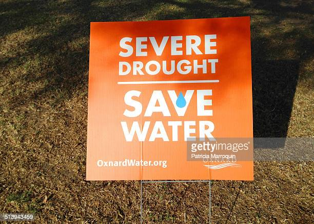 Signs warning residents of an extreme drought and urging lower consumption of water line the perimeter of a high school in Oxnard California