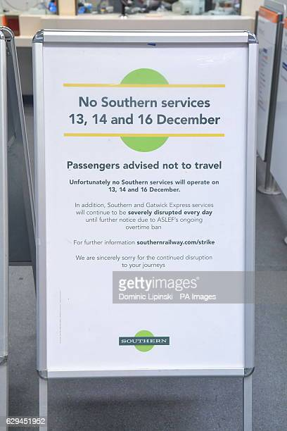 Signs warns passengers of disruption at New Cross Gate station in SE London as a strike by train drivers on Southern Railway in a dispute over...