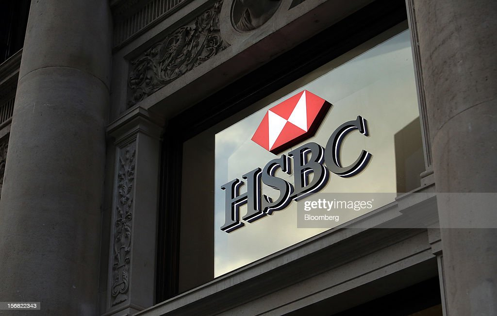 A signsits above the entrance to a HSBC Holdings Plc bank branch in London, U.K., on Thursday, Nov. 22, 2012. Shares of HSBC have climbed 26 percent this year in London trading, and 30 percent in Hong Kong, as Chief Executive Officer Stuart Gulliver pared costs and sold assets to revive profit and focus on emerging economies in which the bank has a greater market share. Photographer: Chris Ratcliffe/Bloomberg via Getty Images