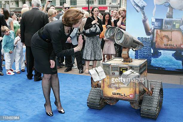 Sigourney Weaver and a model of the character 'WallE' attend the UK Premiere of WALLE at Empire Cinema on July 13 2008 in London England