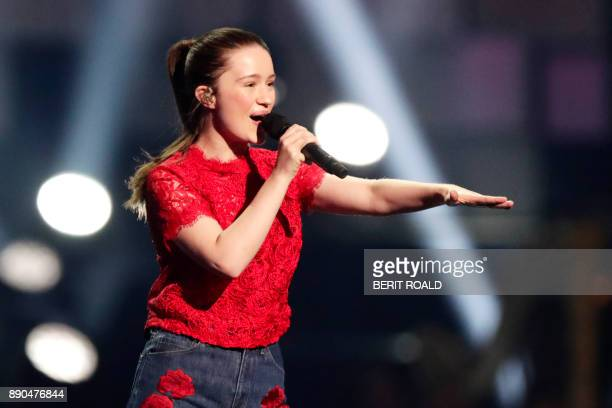 Sigrid performs on stage during the Nobel Peace Prize Concert to honor the peace prize laureates ICAN in Fornebu Norway on December 11 2017 / AFP...
