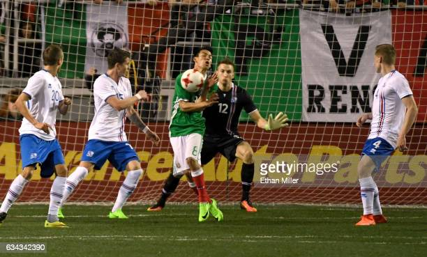 Sigurdur Egill Larusson Vidar Ari Jonsson and Orri Sigurdur Omarsson of Iceland look on as a shot by Mexico caroms off Hirving Lozano of Mexico in...