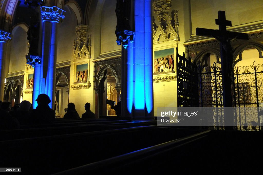 Sigvards Klava leading the Latvian Radio Choir at the Church of St. Mary the Virgin as part of Lincoln Center's White Light Festival on Friday night, November 16, 2012.This image:The soprano Agate Burkina performing in front of the column in the middle.