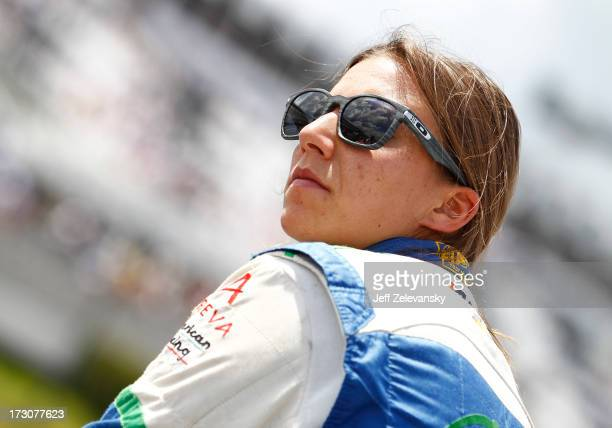 Siimona De Silvestro of Switzerland driver of the Nuclear Entergy Areva KVRT Chevrolet sits at her car during qualifying for the Pocono INDYCAR 400...