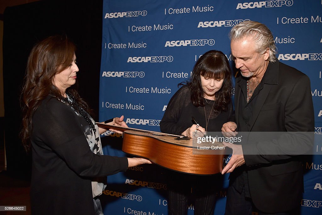 Siinger Pat Benatar (C) and musician Neil Geraldo (R) pose with a #StandWithSongwriters guitar, which will be presented in May to members of Congress to urge them to support reform of outdated music licensing laws, during the 2016 ASCAP 'I Create Music' EXPO on April 30, 2016 in Los Angeles, California.