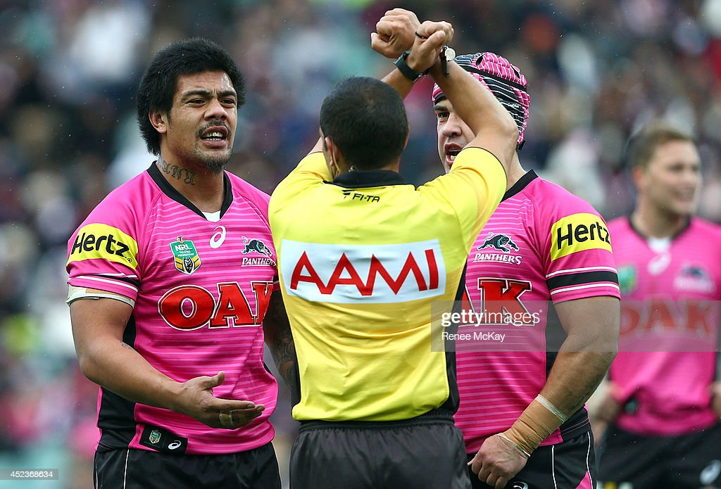 Sika Manu of the Panthers is put on report for a high shot on Roosters five eighth James Maloneyduring the round 19 NRL match between the Sydney Roosters and the Penrith Panthers at Allianz Stadium on July 19, 2014 in Sydney, Australia.
