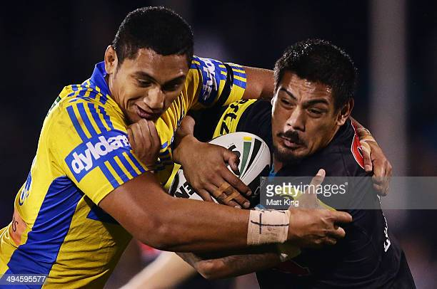 Sika Manu of the Panthers is tackled by Pauli Pauli of the Eels during the round 12 NRL match between the Penrith Panthers and the Parramatta Eels at...