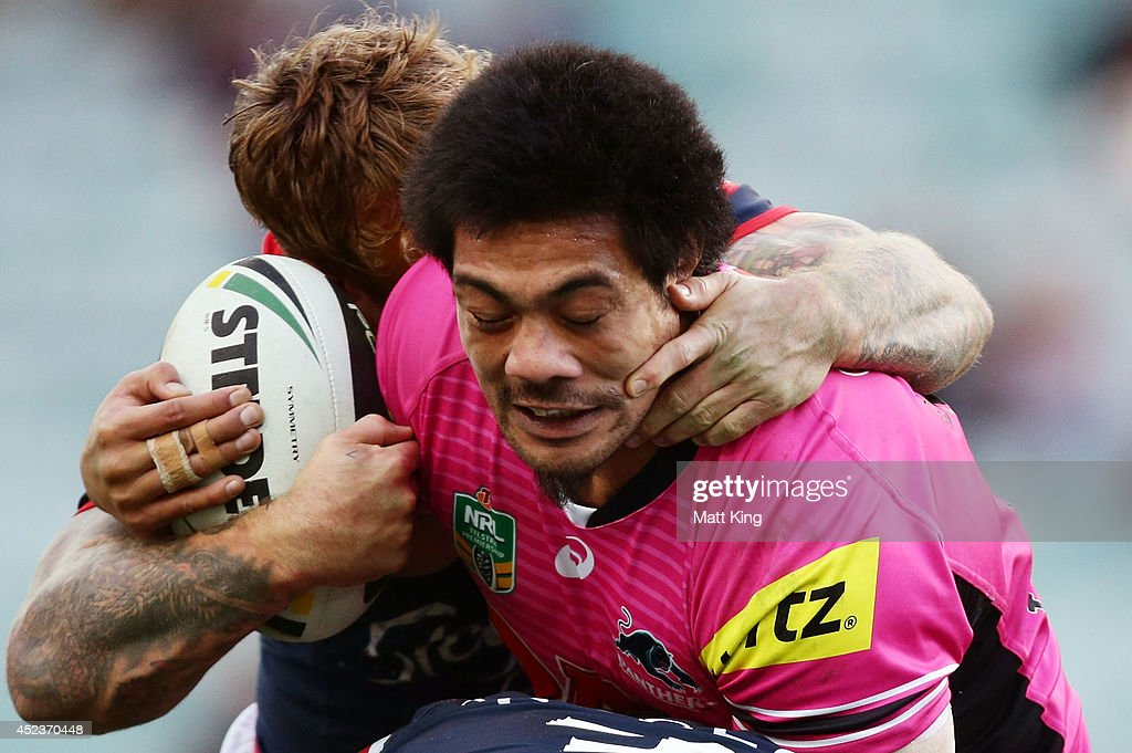 <a gi-track='captionPersonalityLinkClicked' href=/galleries/search?phrase=Sika+Manu&family=editorial&specificpeople=4271513 ng-click='$event.stopPropagation()'>Sika Manu</a> of the Panthers is tackled during the round 19 NRL match between the Sydney Roosters and the Penrith Panthers at Allianz Stadium on July 19, 2014 in Sydney, Australia.