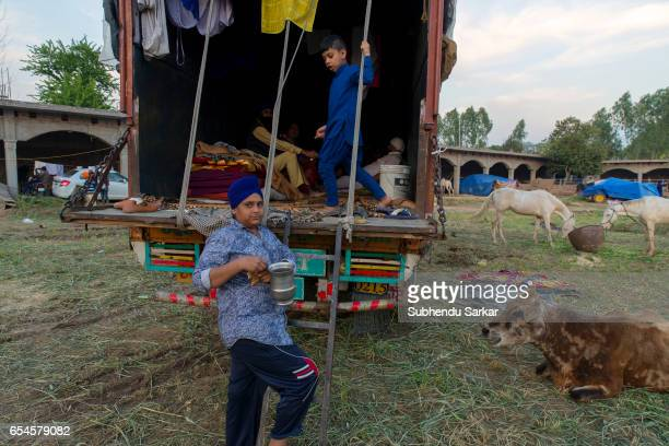 Sikh children play at a camp during Hola Mohalla festival Hola Mohalla is a threeday festival started by the tenth Sikh Guru Govind Singh for the...