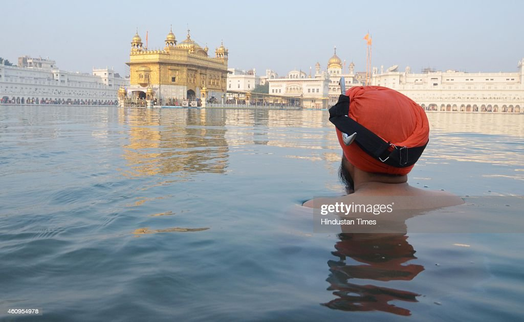 Sikh devotee takes bath in the holy Sarovar and pay obeisance on the first day of the New Year 2015 at the Golden Temple on January 1 2015 in...