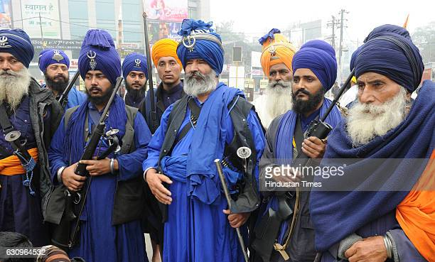 Sikh devotees participate in a Nagar Kirtan on Prakash Parva to celebrate the 350th birth anniversary of Guru Gobind Singh on January 4 2017 in Patna...