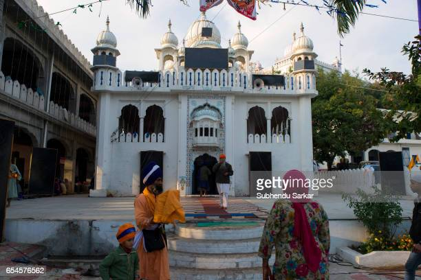 Sikh devotees visit a gurudwara during Hola Mohalla festival Hola Mohalla is a threeday festival started by the tenth Sikh Guru Govind Singh for the...