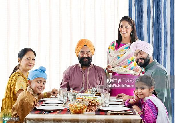 Sikh family having lunch at the dinner table