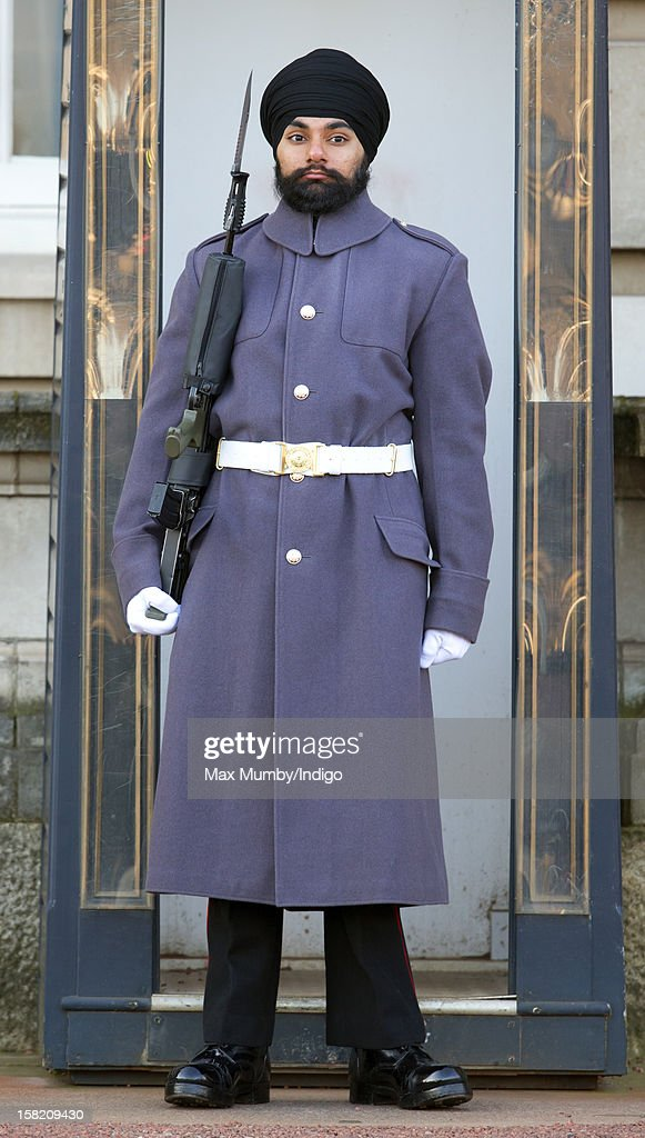 Sikh Guardsman Jatenderpal Singh Bhullar, a soldier in the Scots Guards, stands by his sentry box whilst on guard duty in the forecourt of Buckingham Palace on December 11, 2012 in London, England. Guardsman Bhullar is the first Sikh Guardsman to wear a turban rather than the traditional bearskin whilst on guard duty.