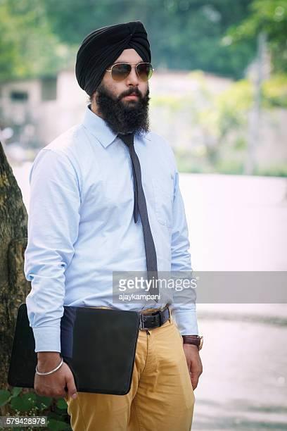 Sikh man holding laptop