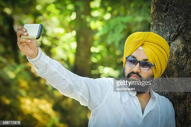 Sikh man taking a selfie