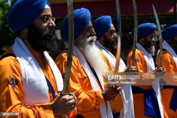 Sikh Panj Pyare or swordsman take part in the second annual American Sikh day parade on May 28 2017 in Denver Colorado The Sikhs hold the parade each...