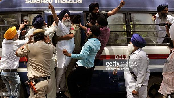 Sikh protesters being taken to police station from outside Congress Party President Sonia Gandhi's residence during a protest against the acquittal...