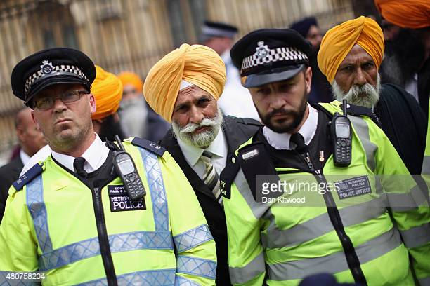 Sikh protestors gather outside the Houses of Parliament on 15 July 2015 in London England Hundreds of demonstrators gathered to call for the British...