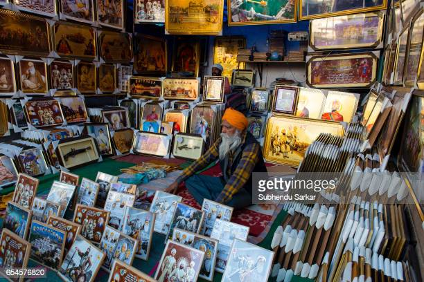 Sikh sells pictures of Sikh religious icons during Hola Mohalla festival Hola Mohalla is a threeday festival started by the tenth Sikh Guru Govind...